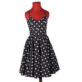 Moderné dámske bodkované šaty Retro